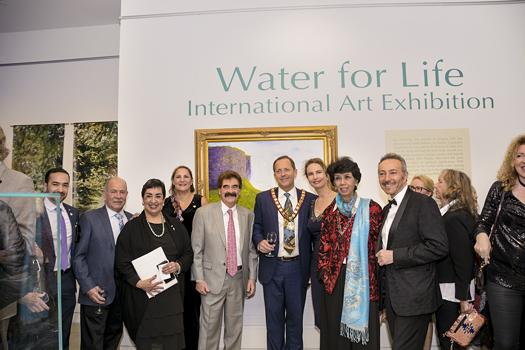 The Patron of the Water for Life, International Art Exhibition, First Edition, the Mayor of Niagara Falls, Jim Diodati, The Honorable, Wayne Gates, Member of Provincial Parliament for Niagara Falls, wih some of the participating artists.