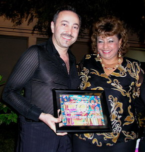 The Representative and Secretary of the Governor of State of Quintana Roo presented to impressionist painter and cancer researcher, Antoine Gaber, a recognition for his cultural contribution and dedication in promoting the arts while supporting cancer awareness in the State of Quintana Roo.